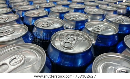 Repeating pattern of beer cans in alcohol and beverage department of superstore