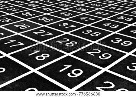 Repetitive pattern of numbers on a playground create an optical illusion. #776566630