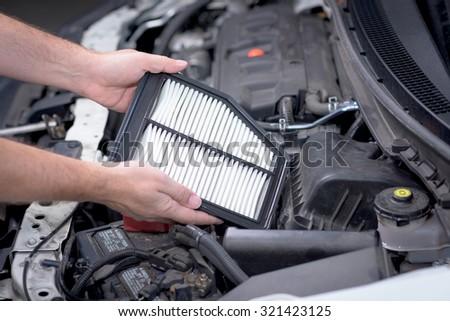 Replacing an air filter in a car #321423125