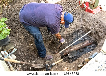 Replacing an old broken sewer line with a brand new one #1189863268