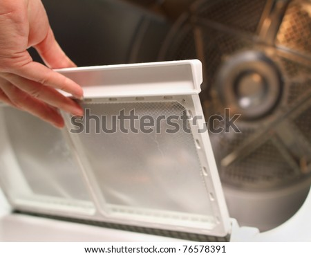 replacing the screen in the lint trap of a clothes dryer
