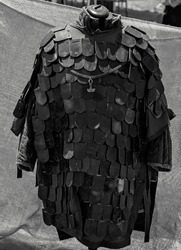 Replica medieval viking armor displayed at a re-enactment village fair in monotone
