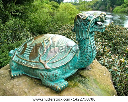 Replica of an old oriental sculpture / symbol showing a turtle - dragon. #1422750788