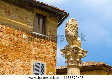 Replica (1856) of the florentine lion at the top of the Marzocco column (1511), Montepulciano, Tuscany, Italy