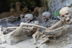 Replica skeletons in the position that the bodies were found after volcanic flow in 79AD Herculaneum Ercolana Campania Italy
