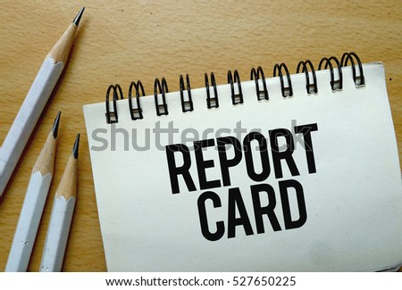 Report Card text written on a notebook with pencils