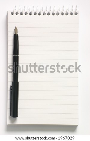 Reporter?s notepad and pen - stock photo