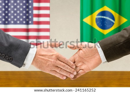 Representatives of the USA and Brazil shake hands