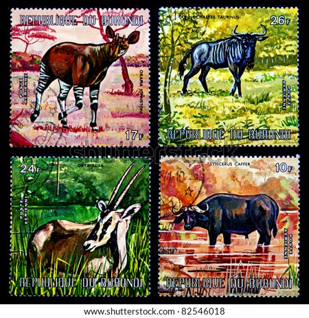 REPUBLIC OF BURUNDI - CIRCA 1977: A stamp printed in Republic of Burundi shows African animals, Okapi, Blue Gnu, East African Oryx and African buffalo, series, circa 1977
