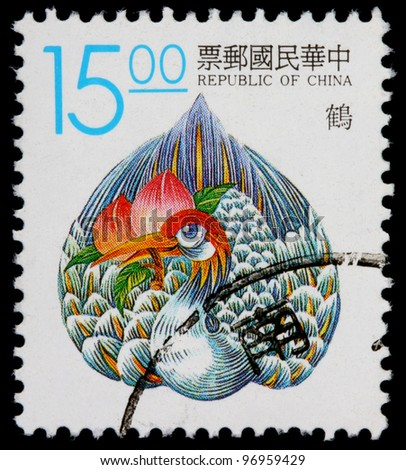 REPUBLIC OF CHINA (TAIWAN) - CIRCA 1990: A 15-dollar stamp printed in the Republic of China (ROC, Taiwan) shows a legendary phoenix bird with a lotus flower in its beak, circa 1990