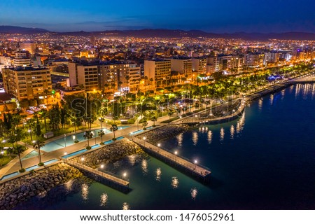 Republic of Cyprus. Night view of Limassol. Lit at night the streets of Limassol. Top view of Cyprus. Holidays in Cyprus. Piers and quay. A pedestrian pier leads to the sea.