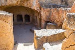 Republic of Cyprus. Pathos. Royal tombs in Paphos. Tombs of kings. Ancient grave niches in stone. Archaeological site of Paphos. Tourist attractions in Cyprus.