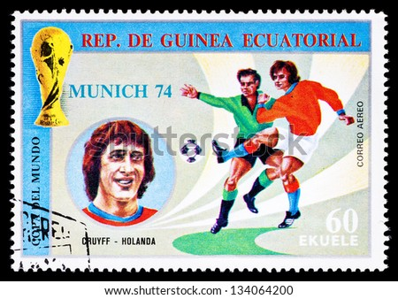 REPUBLIC OF EQUATORIAL GUINEA - CIRCA 1974: A stamp printed in the Republic of Equatorial Guinea shows football player (Champions Cup : Munich, Germany) and portrait Cruyff (Holland), circa 1974.