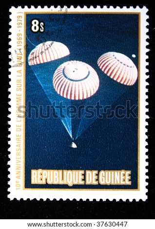 Republic of Guinea - CIRCA 1979: A stamp printed in Republic of Guinea honoring Apollo moon program, shows NASA landing of Apollo-11, one stamp from series, circa 1979