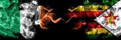 Republic of Ireland, Irish vs Zimbabwe, Zimbabwean, Zimbo smoky mystic flags placed side by side. Thick colored silky abstract smoke flags.
