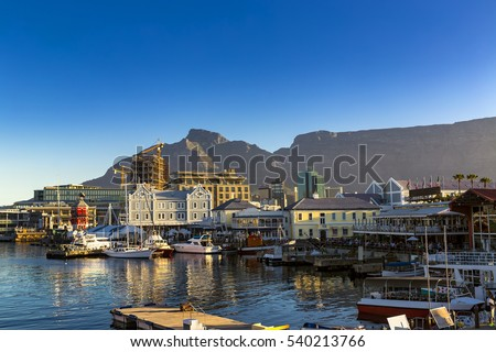 Republic of South Africa. Cape Town (Kaapstad). Waterfront - Victoria Basin with historical buildings. Devil's Peak and Table Mountain in the background #540213766