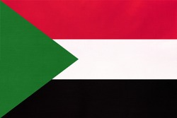 Republic of Sudan national fabric flag, textile background. Symbol of international world African country. State Sudanese official sign.