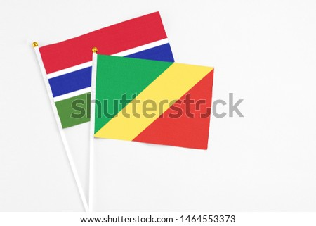 Republic Of The Congo and Georgia stick flags on white background. High quality fabric, miniature national flag. Peaceful global concept.White floor for copy space. #1464553373