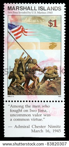 REPUBLIC OF THE MARSHALL ISLANDS - CIRCA 1995: A 1-dollar stamp printed in the Republic of the Marshall Islands shows the raising of the flag when Iwo Jima was captured by U.S. marines, circa 1995