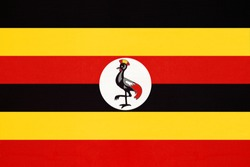 Republic of Uganda national fabric flag, textile background. Symbol of international african world country. State official ugandan sign.