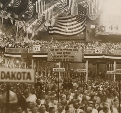 Republican Convention in Chicago, June 1920. In the background, a National Women's Party banner reads, 'Why does the Republican Party Block suffrage? We do not want planks. We demand the 36th state.'