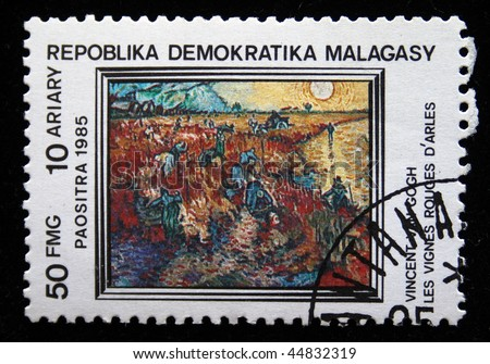 "REPULLICA MALAGASY - CIRCA 1985: A stamp printed in Malagasy (Madagascar) shows paint by artist Vincent van Gogh ""The Red Vineyard"", circa 1985"