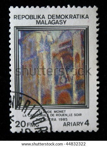 "REPULLICA MALAGASY - CIRCA 1985: A stamp printed in Malagasy (Madagascar) shows paint by artist Claude Monet ""Rouen Cathedral, Facade"", circa 1985"