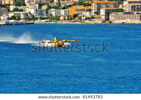 rescue aircraft landing on the sea to put water in. operation to extinguish a forest fire.