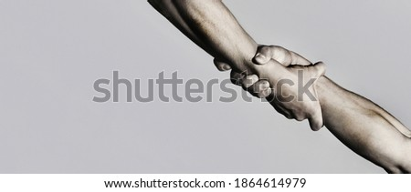 Rescue, helping gesture or hands. Strong hold. Two hands, helping hand of a friend. Handshake, arms, friendship. Close-up Black and white Stock photo ©