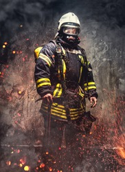 Rescue man in firefighter uniform and oxygen mask.