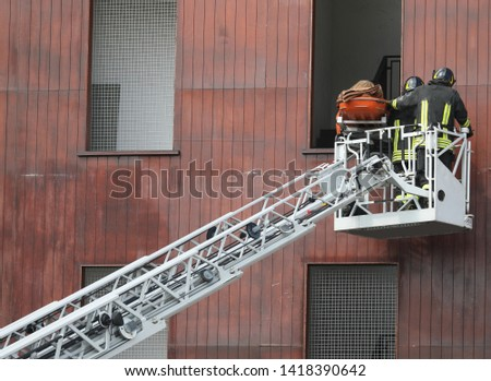 Rescue of an injured person with stretcher on the aerial platform #1418390642