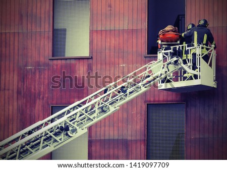Rescue of an injured person with stretcher on the aerial platform and old toned effect #1419097709