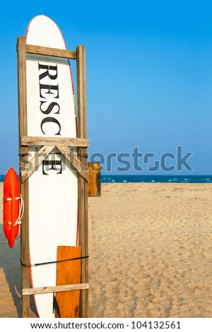 Rescue surfboard on the beach.  Copy space