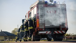 Rescue Team of Firefighters Arrive on the Car Crash Traffic Accident Scene on their Fire Engine. Firemen Grab their Tools, Equipment and, Gear from Fire Truck, Rush to Help Injured, Trapped People