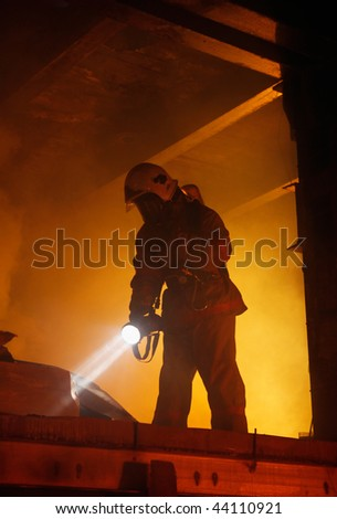 Rescuer search an accident victim in a smoke