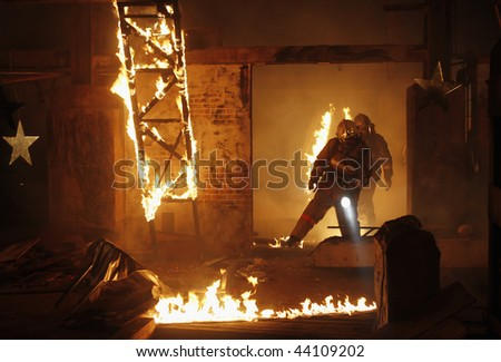 Rescuer search an accident victims on a fire - stock photo