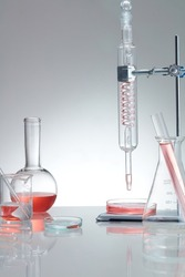 Research and develop product concept with scientific glassware. Concept laboratory tests and research natural extract making cosmetic