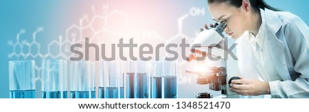 Research and development concept. Double exposure image of scientific and medical lab instrument, microscope, test tube and glass flask for microbiology and chemistry in laboratory for medicine study. Stock photo ©