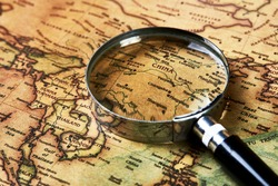 Research Coronavirus epidemic in Wuhan. Magnifying glass on Paper map over China healthcheck. Medical concept tourism travel care diseases healthy, close-up