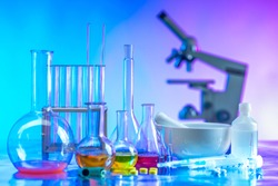 Research in the field of medicine. Chemical laboratory with a microscope. Glass flasks with liquids. Microscope is on the table. Development of medicinal priporatov. Chemistry in medicine.
