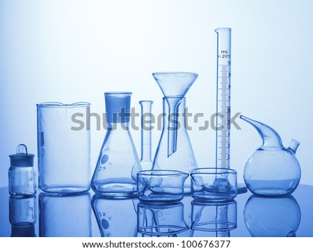 Research Lab assorted Glassware Equipment on blue background