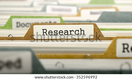 Research on Business Folder in Multicolor Card Index. Closeup View. Blurred Image.