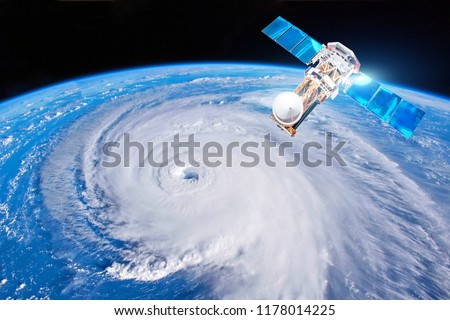 Research, probing, monitoring hurricane. Satellite above the Earth makes measurements of the weather parameters. Elements of this image furnished by NASA
