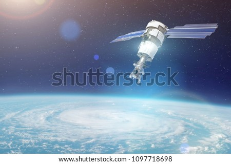 Stock Photo Research, probing, monitoring of tracking in a cyclonic vortex, a hurricane. Satellite above the Earth makes measurements of the weather parameters. Elements of this image furnished by NASA