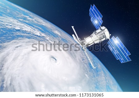 Stock Photo Research, probing, monitoring of tracking in a tropical storm zone, hurricane. Satellite above the Earth makes measurements of the weather parameters. Elements of this image furnished by NASA
