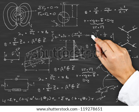 Research scientist writing physics diagrams and formulas with chalk on blackboard