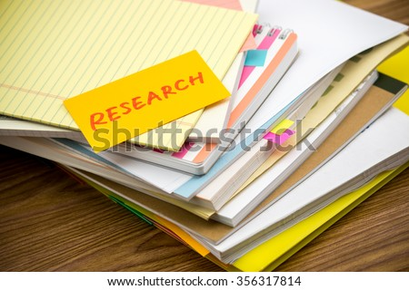 Research; The Pile of Business Documents on the Desk