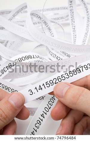 Researcher holding start of printout of the number PI