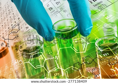 Researcher \'s gloved hand holding the test tubes at laboratory, with chemical equations and periodic table background.