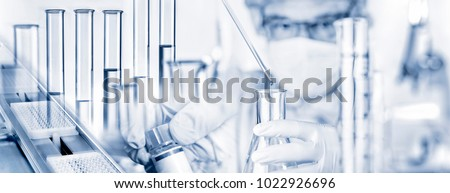 researcher with pipette and...